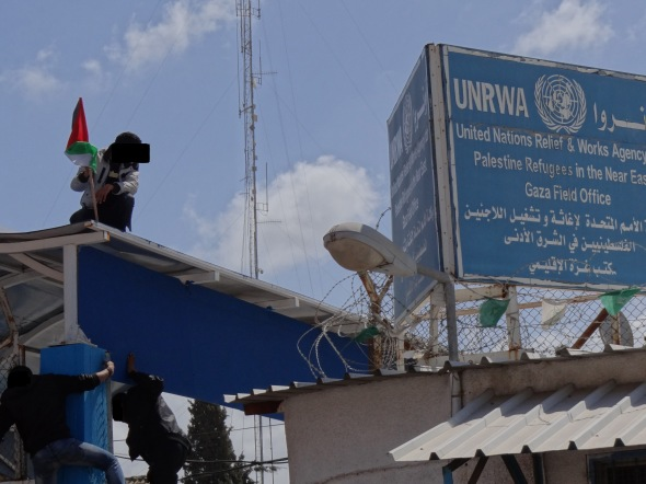 The Palestinian flag is hoist above UNRWA