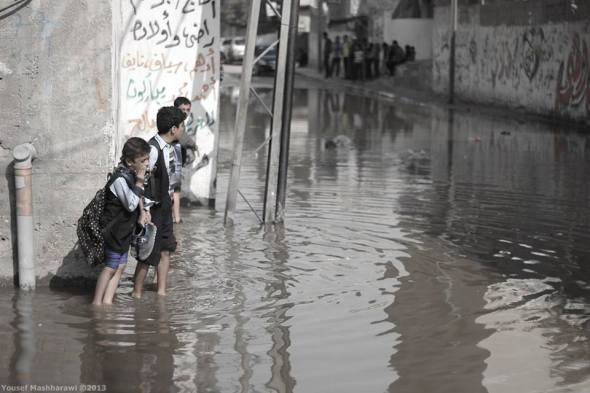 Gaza streets awash with sewage. Photo: Majed Abusalama