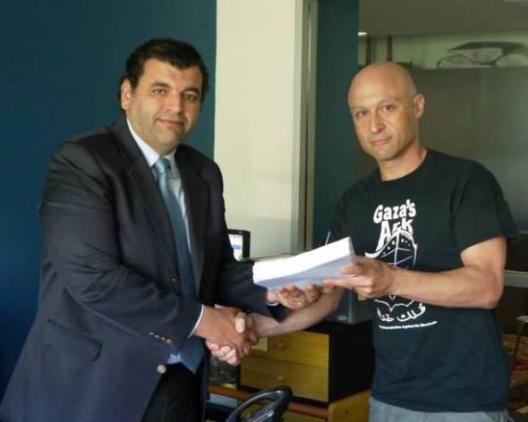James Godfrey presents the petition to Ahmed Morsy in Sydney