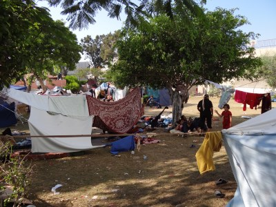 Displaced families in makeshift tents in Shifa Hospital grounds