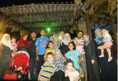 Mohammed Al Rantisi (in blue, center), with the rest of the Al-Rantisi family in happier days