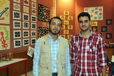 Mohammed Al Rantisi (right) with his friend and business partner Sajed (left). Their business was destroyed by five missiles from Israeli F16s.