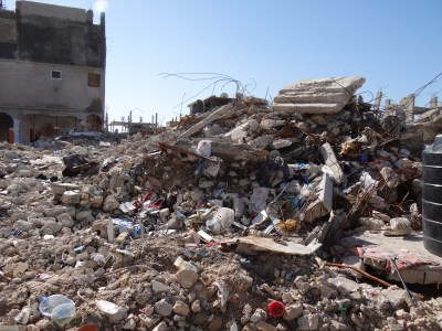 This pile of rubble was once a four-storey house – 13 people were killed here (400 x300)